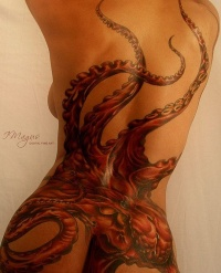 Awesome red octopus tattoo on back for women