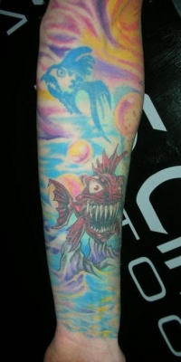 Crazy toothy fish tattoo on whole hand