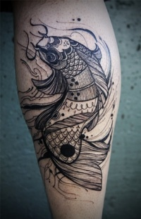 Tattoo fish on the calf muscle legs